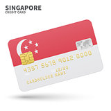 Credit card with Singapore flag background for bank, presentations and business. Isolated on white