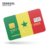 Credit card with Senegal flag background for bank, presentations and business. Isolated on white