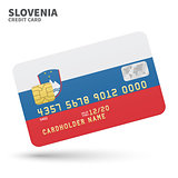 Credit card with Slovenia flag background for bank, presentations and business. Isolated on white