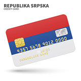 Credit card with Republika Srpska flag background for bank, presentations and business. Isolated on white