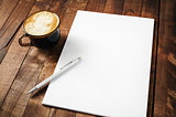 Letterhead, coffee cup and pen