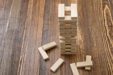 The tower of wooden blocks placed on a table.