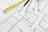 Measuring Tape, Pencil, Ruler and Compass Resting on House Plans