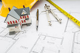 Home, Measuring Tape, Hard Hat, Pencil, Compass on House Plans