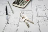 Pencil, Ruler, Calculator and Keys Resting on House Plans