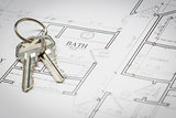 Set Of New House Keys Resting On House Plans