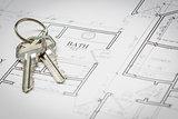 Set Of New House Keys Resting On House Plans