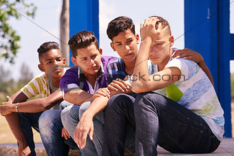 Group Of Teenagers Boys Supporting Comforting Friend