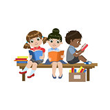 Kids Sitting On The Desk Reading