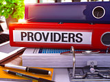 Providers on Red Ring Binder. Blurred, Toned Image.