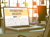 Promoting Website on Laptop in Modern Workplace Background.