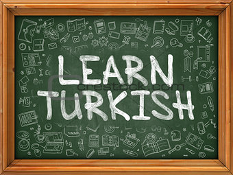 Green Chalkboard with Hand Drawn Learn Turkish.