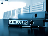 Schedules on Office Binder. Blurred Image.