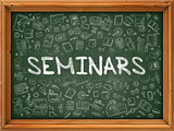 Hand Drawn Seminars on Green Chalkboard.