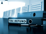 Tax Refund on Office Binder. Blurred Image.