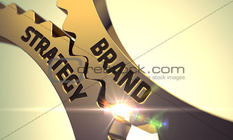 Brand Strategy on Golden Metallic Cog Gears.