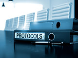 Protocols on Ring Binder. Blurred Image.
