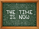 Green Chalkboard with Hand Drawn the Time is Now.