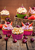 Delicious cupcakes decorated with caramel and fresh berries
