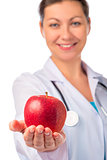 Smiling doctor holding a red apple in the palm