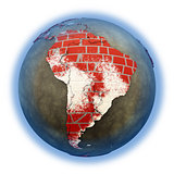 South America on brick wall Earth