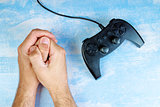 Man resisting video game addiction
