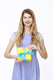 Young woman portrait holding gift