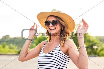 Portrait of laughing girl in hat on summer vacation