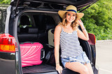 Vacation, Travel concept - young woman ready for the journey on summer holidays with suitcases and car