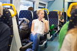 Woman travelling by train.