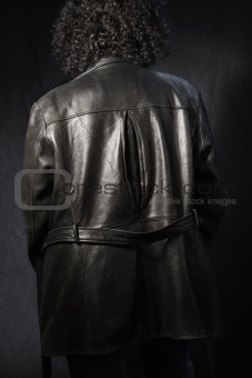 Back of woman in leather coat.