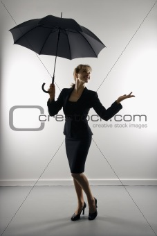 Businesswoman with umbrella.