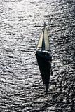 Backlit sailboat.