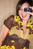 Woman and miniature camera.