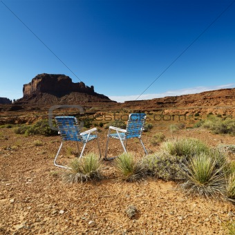 Chairs in desert.