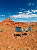 Lawn chairs in desert.