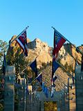 Mount Rushmore with flags.