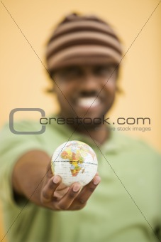 Man with small globe.