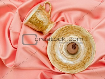 Saucer and cup with chocolate