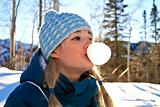 Young girl blowing a bubble