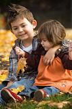 Brother and Sister Playing in the fall