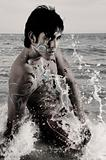 Waves splashing on male model