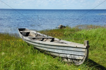 Old fishing boat on the lake bank