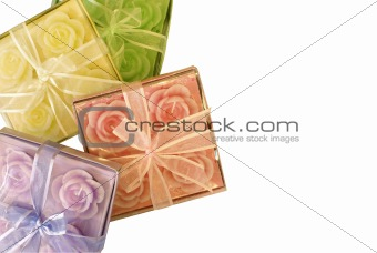 four boxes with aroma candles