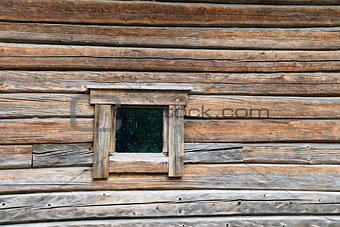Small window on log wall