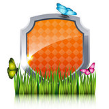 Orange shield with flying butterflies by the grass.