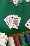 Cards with poker hand with chips and money