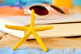 starfish, book and sunglasses