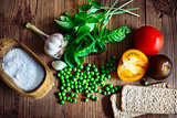 Basil, color tomatoes, garlic, green peas and two crispbread