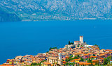 Top view to ancient tower and colorful houses in Malcesine old town